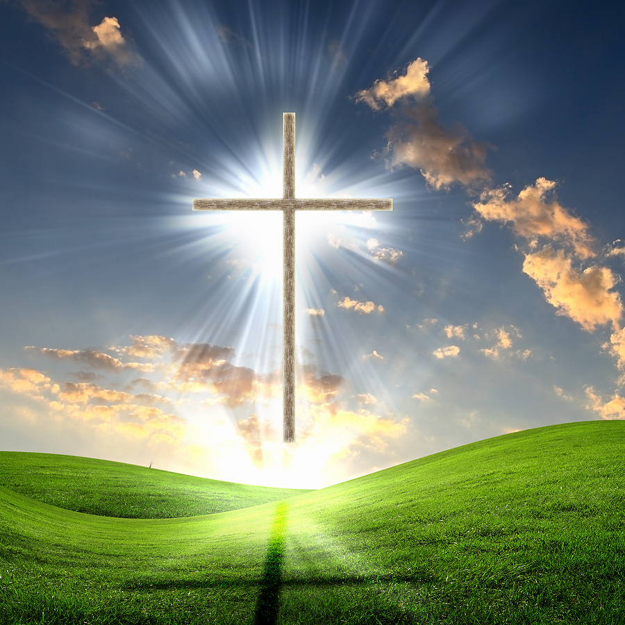 bigstock-Christian-cross-against-the-sk-211100484
